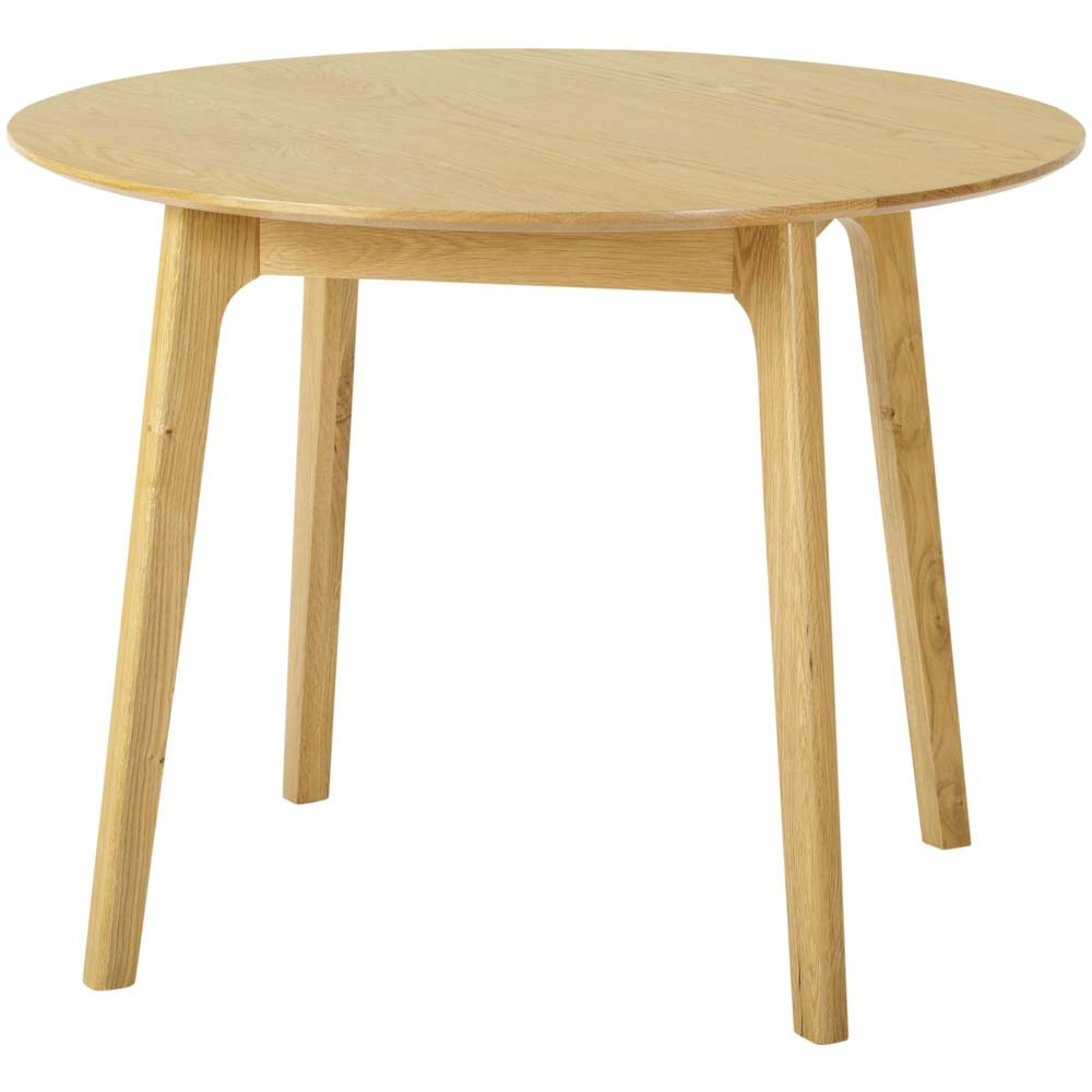 Small round dining table made from oak