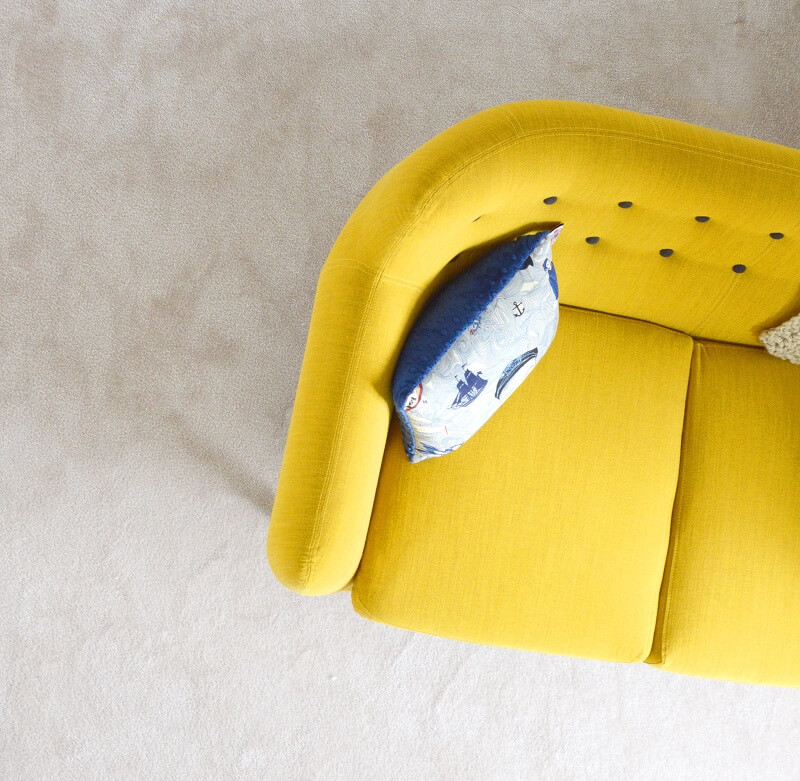 Bright yellow sofa in living room in 2020
