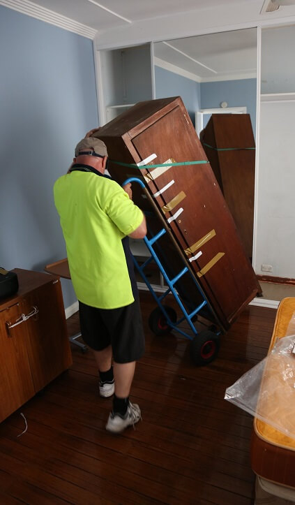 Moving heavy furniture with a hand truck
