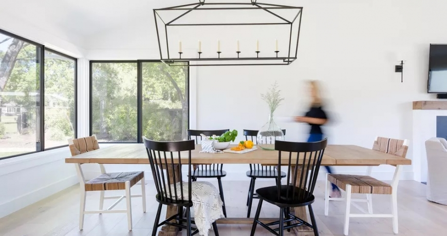 mismatched dining chairs at a table